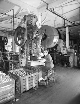 [A woman at work at] Dominion Electrohome Industries