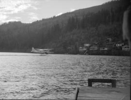 [Canadian Pacific Air Lines seaplane landing on the water]