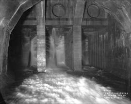[Water running through] temporary gates at sluice tower 24th June 1913