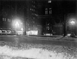 [A street at night covered with snow]