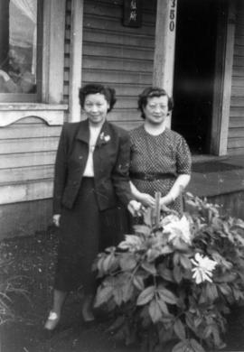 Lillian Ho Wong and Winnifred Eng at the alley entrance to 350 East Pender Street