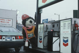 Tillicum pumping gas at Tremblay and Sons Chevron Station on 4th Avenue and Macdonald Street