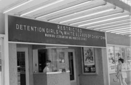Lux Theatre sign for the movies Detention Girls and White Slaves of Chinatown in the unit block o...