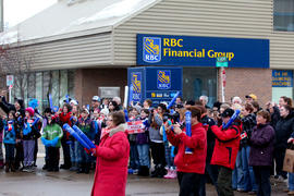Day 78 Crowd gathers at an RBC branch to watch the flame pass in Alberta.