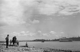 "[People on West Vancouver beach watching the S.S. ""Prince Robert"" in harbour]"