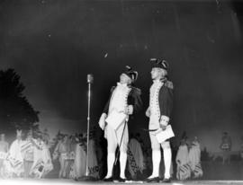 [Two men in period costumes on stage during Diamond Jubilee Celebrations]