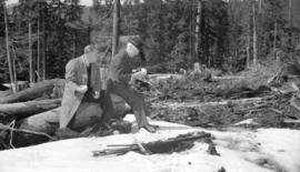 [Premier John Hart and a man in a cleared area of Hollyburn Mountain during a visit to review a t...