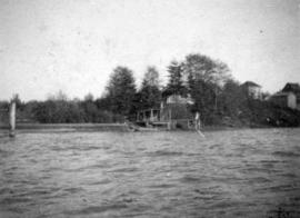[View of house built on posts on the bank of False Creek]