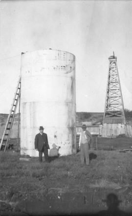 Oil country - [L.D. Taylor and Dr. Grossman in front of Dingman well, Turner Valley, Alberta]