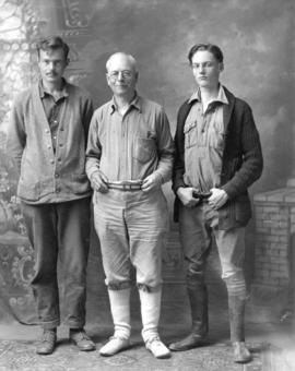 [Full length studio portrait of L.D. Taylor with sons Ted and Ken]