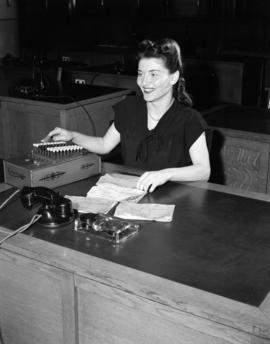 [B.C. Telephone employee using a Comptemeter adding machine]