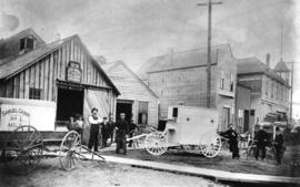 [The first ambulance built by Thomas Lobb in front of his blacksmith business on Westminster Road...