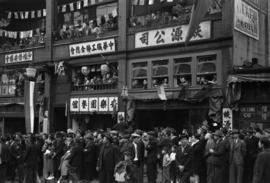 [Crowds in windows and balconies and on Pender Street during VJ Day celebrations]