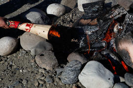 Aboriginal torch is used to carry the flame from the Flame Creation to Lytton's Community Celebra...