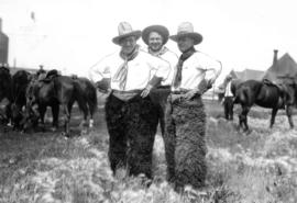 Mayor L.D. Taylor wearing cowboy hat and chaps, with friends Gale and McGeer