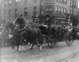 [Mayor L.D. Taylor in horse drawn carriage with Col. Duffus, head of the Northwest Mounted Police...