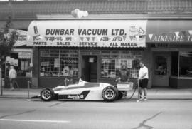 [Dunbar vacuum ltd. with sports car out front. Dunbar Days event]