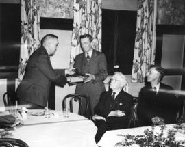 [E.W. Arnott, Vice President of B.C. Electric Railway presents a gavel to Fred Saunders to commem...