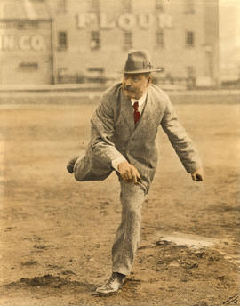 [Mayor L.D. Taylor pitching baseball]
