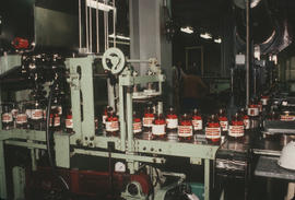 Rogers Golden syrup [being packaged in jars]