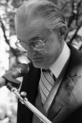 Norman Young speaking into microphone