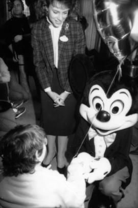 Mickey Mouse interacting with child