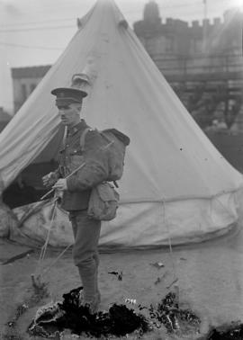 [Man in military uniform in camp]