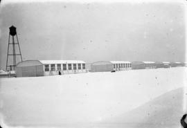 Hangars [at] Camp Everman [in the] snow