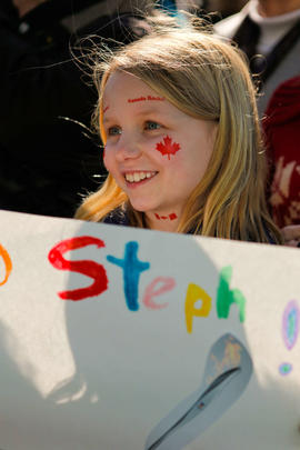 Young girl cheers on her torchbearer at Victoria's Community Celebration in British Columbia