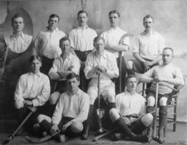 [Group studio portrait of men's field hockey team]