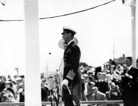 [King George VI and Queen Elizabeth on a reviewing stand at Beacon Hill Park]