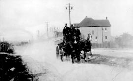 [Horse drawn hose wagon racing east in the 1500 block of Broadway]
