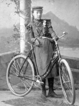 [Miss Frank Eleanor Mills and bicycle, age 12]