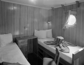 [Interior view of a cabin on board a Union Steamships vessel]