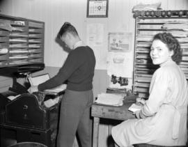 [Man and woman in a Kelly Douglas Ltd. office]