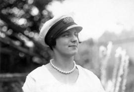 [Unidentified young woman wearing ship captain's hat at City Hall employee picnic]