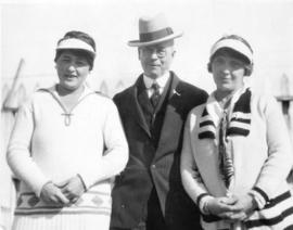[L.D. Taylor outdoors with two women]