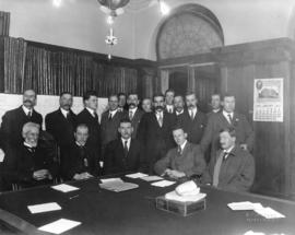 [John Davidson and others in unidentified department in Parliament Buildings]