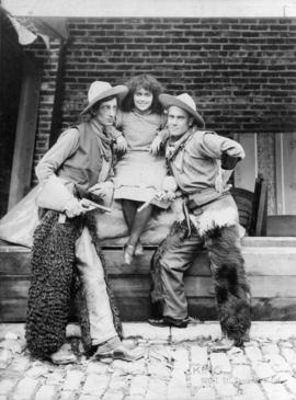 [Alfred T. Layne, actor, posed with fellow actor and actress in western costumes]