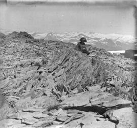 [Unidentified woman sitting on crag in Garibaldi District]