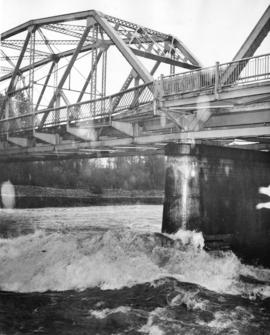 [Water surging under Capilano Creek Bridge]
