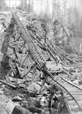 [Elevated rails at the Buntzen Lake Dam construction site]