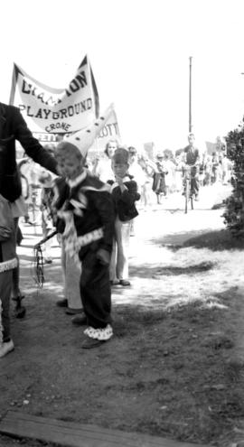 Young boy dresses as a clown in a children's parade in Kitsilano