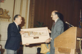 Mike Harcourt presents framed print to unidentified man