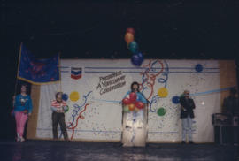 Group wearing costumes perform on the Chevron Stage