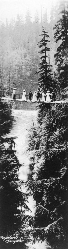 [Group of men and women on suspension bridge], Capilano Canyon