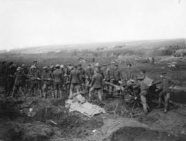 [Soldiers drag a field gun into position on the Western Front]