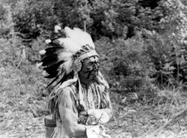 [Chief Joe Capilano wearing a feather headdress during the royal visit]