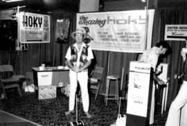 Hoky display and demonstration of powerless carpet sweepers