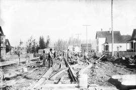 [Men building streetcar tracks on Powell Street, between Hawks and Campbell Streets]